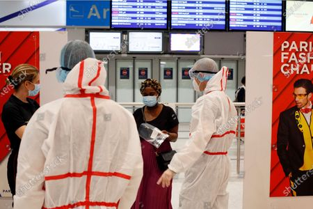 Passenger arrives to be tested with the COVID-19 test, at the Roissy Charles de Gaulle airport, outside Paris, . Travelers entering France from 16 countries where the coronavirus is circulating widely are having to undergo virus tests upon arrival at French airports and ports