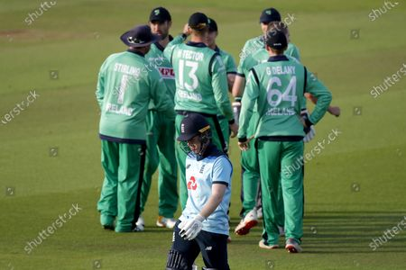 England captain Eoin Morgan (bottom) leaves the pitch after being caught out by Ireland's Curtis Campher, during the Second One Day Cricket International of the Royal London Series between England and Ireland, at the Ageas Bowl, in Southampton, England