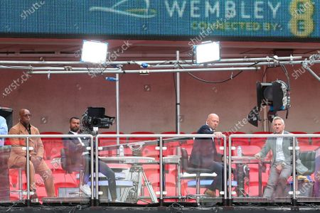 From left, Ian Wright, Ashley Cole, Alan Shearer and Gary Lineker watch the FA Cup final soccer match between Arsenal and Chelsea at Wembley stadium in London, England, Saturday, Aug.1, 2020