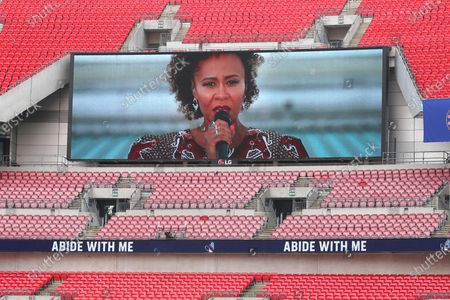 Recording of Emeli Sande singing Abide With Me plays on screens ahead of FA Cup final soccer match between Arsenal and Chelsea at Wembley stadium in London, England, Saturday, Aug.1, 2020