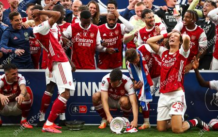 Arsenal's Pierre-Emerick Aubameyang (L) drops the FA Cup trophy as his team celebrates following the English FA Cup final between Arsenal London and Chelsea FC at Wembley stadium in London, Britain, 01 August 2020.