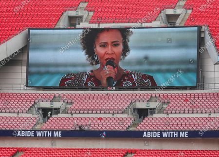 "Emeli Sande sings ""Abide With Me"" shown on the big screen prior to the English FA Cup final between Arsenal London and Chelsea FC at Wembley stadium in London, Britain, 01 August 2020."