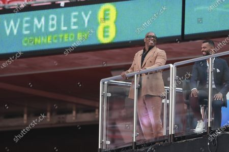 Pundits and former players Ian Wright, left, and Ashley Cole smile during the FA Cup final soccer match between Arsenal and Chelsea at Wembley stadium in London, England