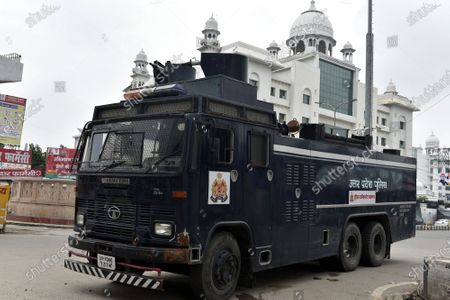 A police vehicle deployed as part of security arrangements on Eid al-Adha and a weekend lockdown, at KGMU Road, on August 1, 2020 in Lucknow, India. The holy festival of sacrifice, which falls on the 10th day of Dhu al-Hijjah as per the Islamic lunar calendar, is being celebrated today. Bakra Eid or Bakrid is marked by sacrificing an animal that is close to them to prove their devotion and love for Allah. Post the sacrifice, devotees distribute the offering to family, friends, neighbours and especially to the poor and the needy.