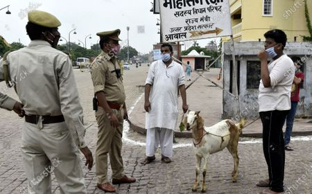 Police personnel checking people out and about on Eid al-Adha and a weekend lockdown, at Kudiaghat Road, on August 1, 2020 in Lucknow, India. The holy festival of sacrifice, which falls on the 10th day of Dhu al-Hijjah as per the Islamic lunar calendar, is being celebrated today. Bakra Eid or Bakrid is marked by sacrificing an animal that is close to them to prove their devotion and love for Allah. Post the sacrifice, devotees distribute the offering to family, friends, neighbours and especially to the poor and the needy.