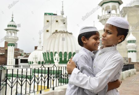 Children greet each other after offering Eid-ul-Adha prayers, at Khairudeen Mosque, on August 1, 2020 in Amritsar, India. The holy festival of sacrifice, which falls on the 10th day of Dhu al-Hijjah as per the Islamic lunar calendar, is being celebrated today. Bakra Eid or Bakrid is marked by sacrificing an animal that is close to them to prove their devotion and love for Allah. Post the sacrifice, devotees distribute the offering to family, friends, neighbours and especially to the poor and the needy.