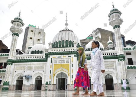 Children walk in the mosque courtyard after offering Eid-ul-Adha prayers, at Khairudeen Mosque, on August 1, 2020 in Amritsar, India. The holy festival of sacrifice, which falls on the 10th day of Dhu al-Hijjah as per the Islamic lunar calendar, is being celebrated today. Bakra Eid or Bakrid is marked by sacrificing an animal that is close to them to prove their devotion and love for Allah. Post the sacrifice, devotees distribute the offering to family, friends, neighbours and especially to the poor and the needy.