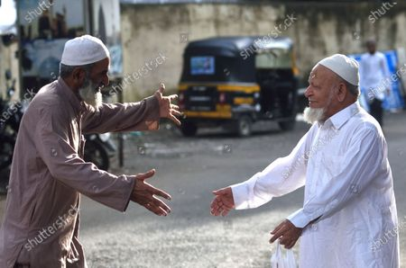 Muslims greet each other on the occasion of Eid Al-Adha at Jogeshwari, on August 1, 2020 in Mumbai, India. The holy festival of sacrifice, which falls on the 10th day of Dhu al-Hijjah as per the Islamic lunar calendar, is being celebrated today. Bakra Eid or Bakrid is marked by sacrificing an animal that is close to them to prove their devotion and love for Allah. Post the sacrifice, devotees distribute the offering to family, friends, neighbours and especially to the poor and the needy.