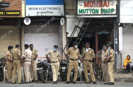 Mumbai police security near the Muslim located area on the occasion of Eid-Al-Adha at Jogeshwari, on August 1, 2020 in Mumbai, India. The holy festival of sacrifice, which falls on the 10th day of Dhu al-Hijjah as per the Islamic lunar calendar, is being celebrated today. Bakra Eid or Bakrid is marked by sacrificing an animal that is close to them to prove their devotion and love for Allah. Post the sacrifice, devotees distribute the offering to family, friends, neighbours and especially to the poor and the needy.
