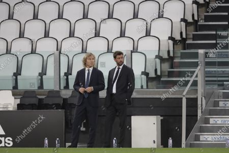Juventus' president Andrea Agnelli, right, and his Vice President Pavel Nedved attend a Serie A soccer match between Juventus and Roma, at the Allianz stadium in Turin, Italy, Saturday, Aug.1, 2020