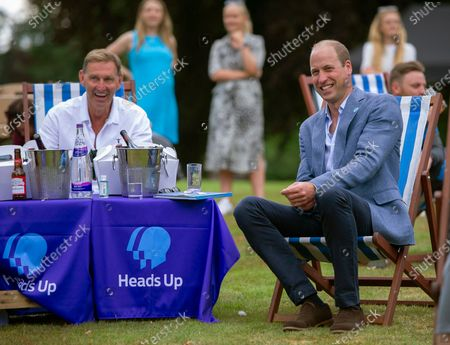 Britain's Prince William, right, sits with former Arsenal player Tony Adams and representatives from Heads Up, Calm, Mind and Shout, and frontline workers from Norfolk, during a screening of the Heads Up FA Cup Final between Arsenal and Chelsea, at the Sandringham Estate to mark the culmination of the Heads Up campaign, in Norfolk, England