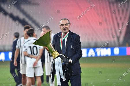 Juventus' head coach Maurizio Sarri celebrates with the trophy the victory of the 9th consecutive Italian championship after the Italian Serie A soccer match Juventus FC vs AS Roma at the Allianz stadium in Turin, Italy, 01 August 2020.