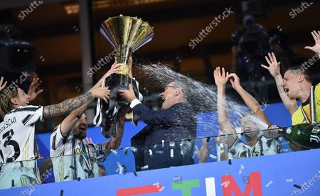 Head coach Maurizio Sarri and Giorgio Chiellini jubilate with the cup during the celebrations for the Juventus' victory of the 9th consecutive Italian championship (scudetto) at Allianz Stadium in Turin, Italy, 01 August 2020.