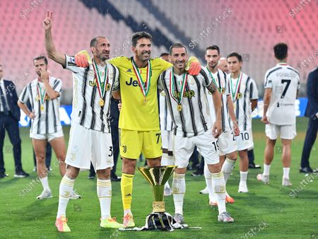 (L-R) Giorgio Chiellini, Gigi Buffon and Leonardo Bonucci jubilate during the celebrations for the Juventus' victory of the 9th consecutive Italian championship (scudetto) at Allianz Stadium in Turin, Italy, 01 August 2020.
