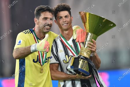Goalkeeper Gigi Buffon (L) and Cristiano Ronaldo jubilate with the cup during the celebrations for the Juventus' victory of the 9th consecutive Italian championship (scudetto) at Allianz Stadium in Turin, Italy, 01 August 2020.