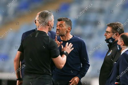 Stock Photo of FC Porto's head coach Sergio Conceicao (C) argues with the referee Manuel Mota (L) during their Portuguese Cup final soccer match against Benfica, held at Coimbra City stadium, Coimbra, Portugal, 1st August 2020.