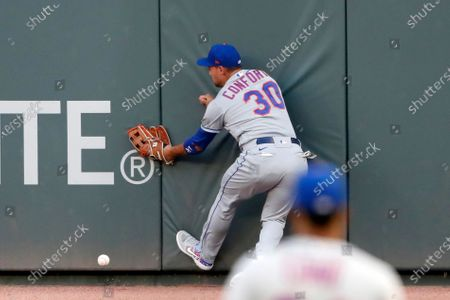 New York Mets right fielder Michael Conforto can't get to a ball hits for an RBI double by Atlanta Braves' Tyler Flowers during the second inning of a baseball game, in Atlanta