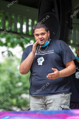 Frank Manzano, co-founder of the anti-racist collective 'If Not Us, Then Who?' addresses a crowd of about 150 people gathered at Cameron Park in Sunbury for a Black Lives Matter protest and march.