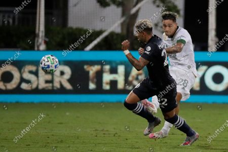 New York City defender Ronald Matarrita, left, moves the ball past Portland Timbers'Pablo Bonilla, during the first half of an MLS soccer match, in Kissimmee, Fla