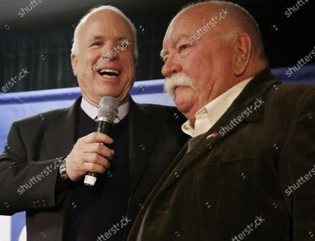 """Republican presidential hopeful, Sen. John McCain, R-Ariz., left, introduces actor, Wilford Brimley, after making a reference to fellow Republican presidential hopeful, former Arkansas Gov. Mike Huckabee, campaigning with actor Chuck Norris, as McCain makes a campaign stop at Hudson Veterans of Foreign Wars Post 5791, in Hudson, N.H. Brimley, who worked his way up from stunt performer to star of film such as """"Cocoon"""" and """"The Natural,"""" has died. He was 85. Brimley's manager Lynda Bensky said the actor died Saturday morning, Aug. 1, 2020 in a Utah hospital"""