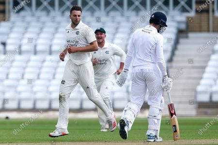Tom Barber of Nottinghamshire CCC celebrates taking the wicket of Ben Aitchison of Derbyshire CCC