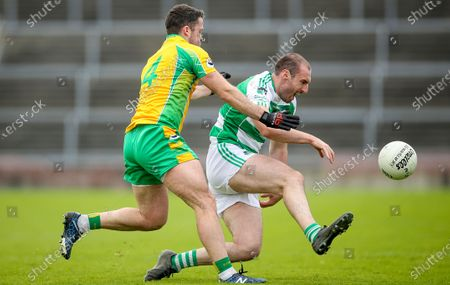 Corofin vs Oughterard. Corofin's Conor Cunningham with Patrick Walsh of Oughterard