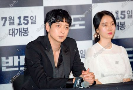 "Stock Image of Gang Dong-Won and Lee Jung-Hyun : South Korean actor Gang Dong-Won (L) and actress Lee Jung-Hyun attend a press conference for movie ""Peninsula"" in Seoul, South Korea. Movie ""Peninsula"" is a sequel to 2016 zombie blockbuster ""Train to Busan"" and tells a tale of survivors on the zombie-infested Korean peninsula four years after the events in ""Train to Busan"". The film was selected for the official lineup of this year's Cannes Film Festival."