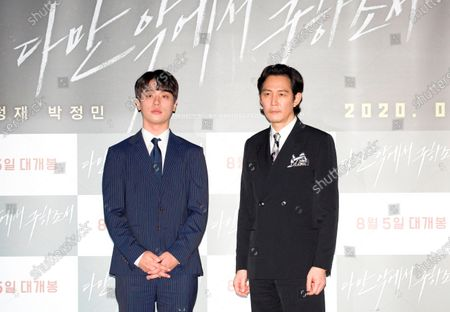 "Stock Image of Park Jung-Min and Lee Jung-Jae : South Korean actors Park Jung-Min (L) and Lee Jung-Jae attend a press conference after a press screening for Korean movie ""Deliver Us From Evil"" in Seoul, South Korea. The action thriller's background is Japan, South Korea and Thailand."