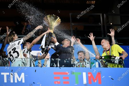 Coach Maurizio Sarri of Juventus FC. Juventus FC players hold up the trophy after winning the Serie A Championship 2019-2020