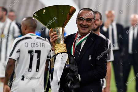 Coach Maurizio Sarri of Juventus FC celebrates with the trophy after winning the Serie A Championship 2019-2020.