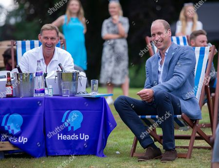 Prince William watches with Tony Adams