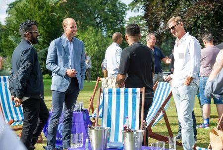 Prince William with Ronesh Ranganathan (left) and former Arsenal player Tony Adams