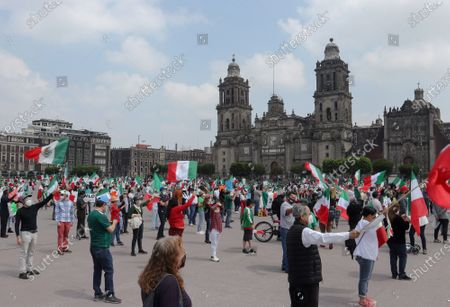 Citizens wave Mexican flags as they participate in a demonstration demanding the resignation of President Andres Manuel Lopez Obrador, in the Zocalo in Mexico City, Mexico, 02 August 2020.Dozens of people from the National Anti Amlo Front (Frena), an organization that every Sunday organizes demonstrations against President Andres Manuel Lopez Obrador, protested in front of the National Palace with Mexican flags.