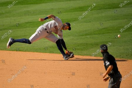 Houston Astros shortstop Carlos Correa can't reach a ball hit for an RBI single by Los Angeles Angels' Michael Hermosillo during the 10th inning of a baseball game, in Anaheim, Calif