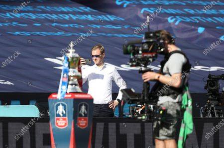 Dan Walker, from BBC Sport, behind the FA Cup at the Emirates FA Cup Final match Arsenal v Chelsea, at Wembley Stadium, London, UK on 1st August, 2020.The match is being played behind closed doors because of the current COVID-19 Coronavirus pandemic, and government social distancing/lockdown restrictions.
