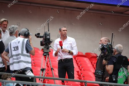 Stock Image of Martin Keown, working as a football pundit at the Emirates FA Cup Final match Arsenal v Chelsea, at Wembley Stadium, London, UK on 1st August, 2020.The match is being played behind closed doors because of the current COVID-19 Coronavirus pandemic, and government social distancing/lockdown restrictions.