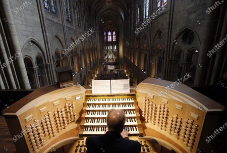 Philippe Lefebvre, 64, plays the organ at Notre Dame cathedral in Paris. Pipe by precious pipe, the organ that once thundered through fire-ravaged Notre Dame Cathedral is being taken apart. The mammoth task of dismantling, cleaning and re-assembling France's largest musical instrument started Monday Aug.3, 2020 and is expected to last nearly four years