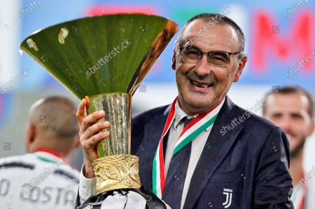 Stock Photo of Coach of Juventus FC Maurizio Sarri celebrates with the trophy after winning the Serie A Championship