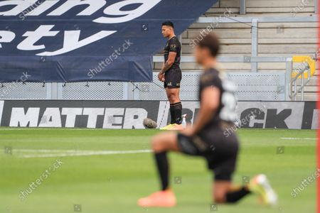 Israel Folau (4) of Catalans Dragons choses to stand and not take the knee as other do for Black Lives Matter Stok Fotoğraf