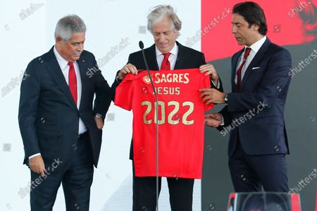 Stock Picture of Benfica president Luis Filipe Vieira (L) and director of football Rui Costa (R), pose with Benfica's new head coach Jorge Jesus (C) during his presentation in Seixal, Portugal, 03 August 2020.