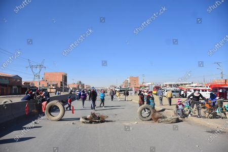 Dozens of people block a road during a protest due to the further postponement of the Bolivian elections, in El Alto, Bolivia, 03 August 2020. Bolivia saw blockades and demonstrations of social sectors that demand that the elections be held on 06 September  and not on 18 October as announced by the country's electoral body.