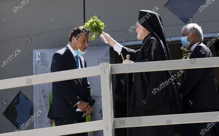 Archbishop Elpidophoros (2-R) of the American Greek Orthodox Church blesses New York Governor Andrew Cuomo (L) during a ceremony to mark the restarting of construction to rebuild St. Nicholas Church and National Shrine, which was destroyed in the 9/11 terrorist attacks, in New York, New York, USA, 03 August 2020. The rebuilding of the church, which was built in 1916 and is the only house of worship destroyed on 9/11, has been stalled due to funding issues but is now expected to be completed by September 2021.