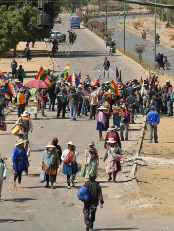 Dozens of people block a road during a protest due to the further postponement of the Bolivian elections, in Cochabamba, Bolivia, 03 August 2020. Bolivia saw blockades and demonstrations of social sectors that demand that the elections be held on 06 September  and not on 18 October as announced by the country's electoral body.