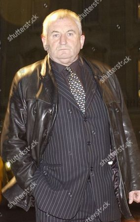 John Bird Founder Of The Big Issue Arrives At A Reception Hosted By Britain's Queen Elizabeth II And Prince Philip To Pay Tribute To The Contribution Of More Than 400 Pioneers To British Life At Buckingham Palace In London October 13 2003.