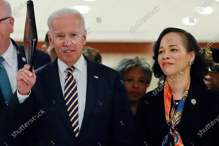 Democratic presidential candidate former Vice President Joe Biden, center, escorted by RRep. Lisa Blunt Rochester, D-Del., right, as they arrive at the House Democratic Issues Conference on Capitol Hill in Washington. The 2020 vice presidential search now rests with Democratic presidential candidate Joe Biden as he prepares to pick just the third woman in history for a major U.S. party's national ticket. There's a group of key advisers who have helped shape his options and present him with reams of pros and cons for potential vice presidents. They include Delaware Rep. Lisa Blunt Rochester, former Connecticut Sen. Chris Dodd, Los Angeles Mayor Eric Garcetti and former Apple executive and longtime Biden adviser Cynthia Hogan. They're aided by lawyers with deep ties to Democratic politics and former President Barack Obama