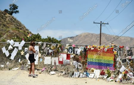 """Marjorie Huot, of Camarillo, Calif., visits a makeshift memorial for the late actress Naya Rivera near Lake Piru, in Los Padres National Forest, Calif., about 55 miles (90 kilometers) northwest of Los Angeles. The 33-year-old """"Glee"""" star was found dead in Lake Piru on July 13, five days after her son, Josey, was found alone on a boat the two had rented there"""