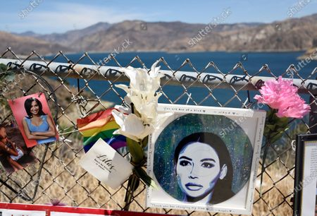 """Makeshift memorial for the late actress Naya Rivera is pictured at Lake Piru, in Los Padres National Forest, Calif., about 55 miles (90 kilometers) northwest of Los Angeles. The 33-year-old Rivera, who played the lesbian cheerleader character Santana Lopez on the television series """"Glee,"""" was found dead in Lake Piru on July 13, five days after her son, Josey, was found alone there on a boat the two had rented"""