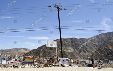 """Fans visit a makeshift memorial for the late actress Naya Rivera at Lake Piru, in Los Padres National Forest, Calif., about 55 miles (90 kilometers) northwest of Los Angeles. The 33-year-old """"Glee"""" star was found dead in Lake Piru on July 13, five days after her son, Josey, was found alone on a boat the two had rented there"""