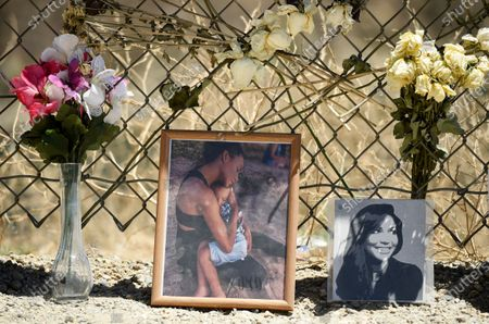 """Photo of the late actress Naya Rivera and her son Josey sits at a makeshift memorial for her at Lake Piru, in Los Padres National Forest, Calif., about 55 miles (90 kilometers) northwest of Los Angeles. The 33-year-old """"Glee"""" star was found dead in Lake Piru on July 13, five days after her son, Josey, was found alone on a boat the two had rented there"""
