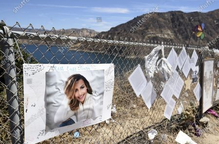 """Makeshift memorial for the late actress Naya Rivera is pictured at Lake Piru, in Los Padres National Forest, Calif., about 55 miles (90 kilometers) northwest of Los Angeles. The 33-year-old """"Glee"""" star was found dead in Lake Piru on July 13, five days after her son, Josey, was found alone on a boat the two had rented there"""
